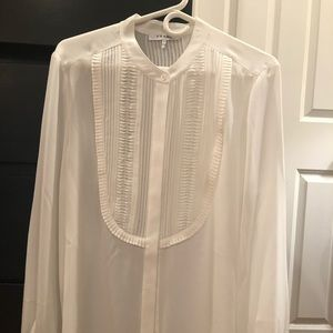 Beautiful never worn silk blouse by Frame!